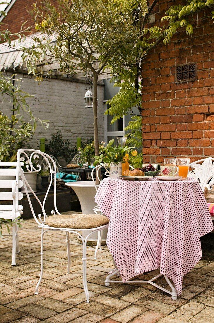 Table set for breakfast on garden patio