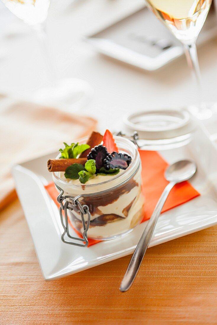 Tiramisu with berries in a glass