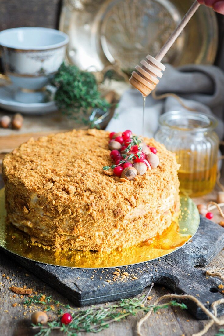 Honey cake with hazelnuts and redcurrants