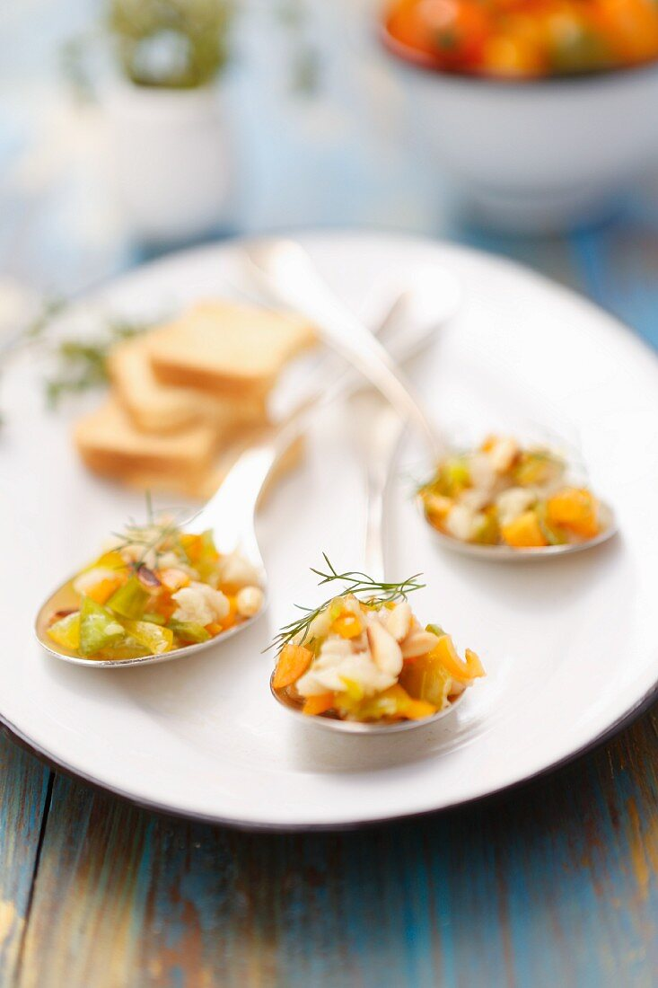 Fish tartare with peppers, fennel and pine nuts