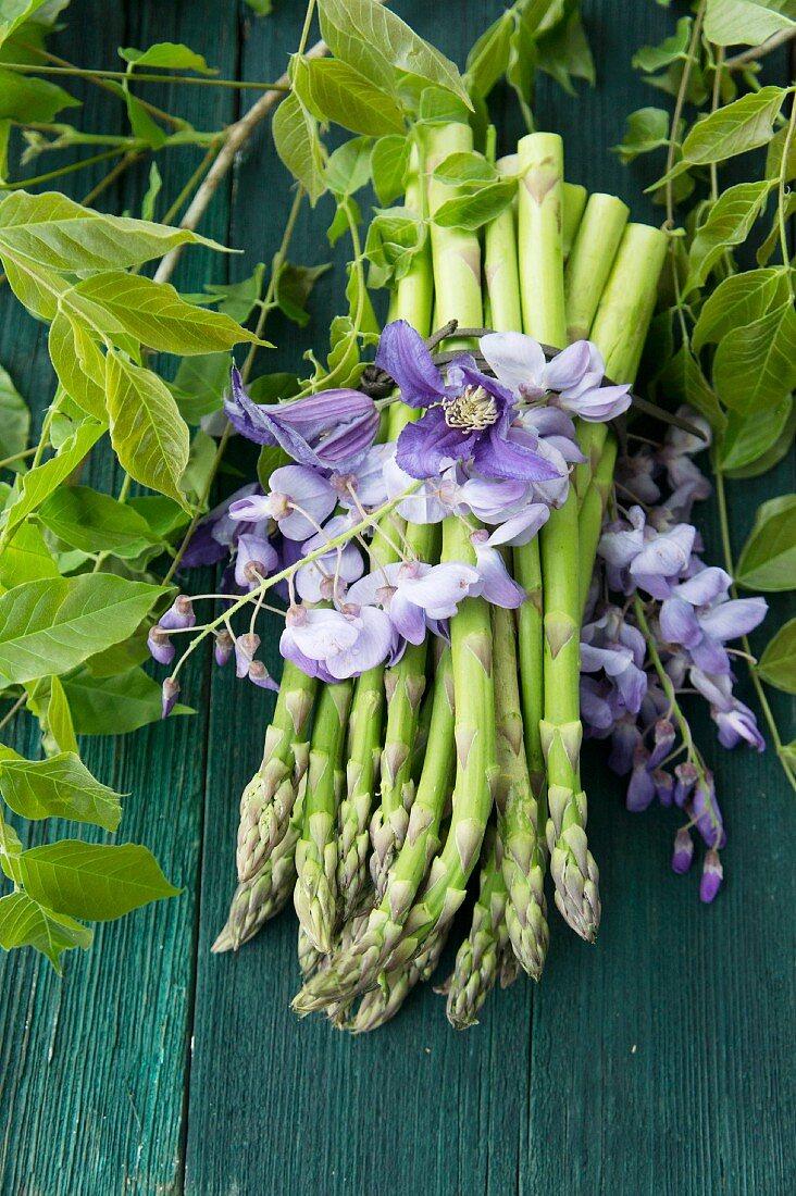 Green asparagus and wisteria blossoms