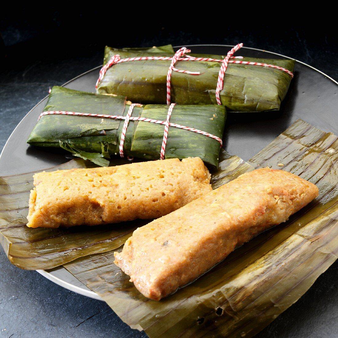 Pastele de Masa, pork pasteles. shredded pork and vegetables in banana leaf