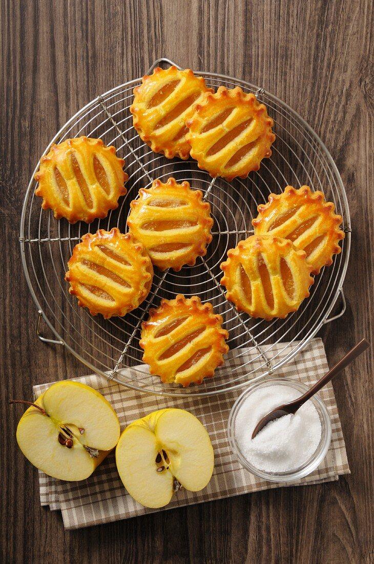 Apple tarts on a cake rack