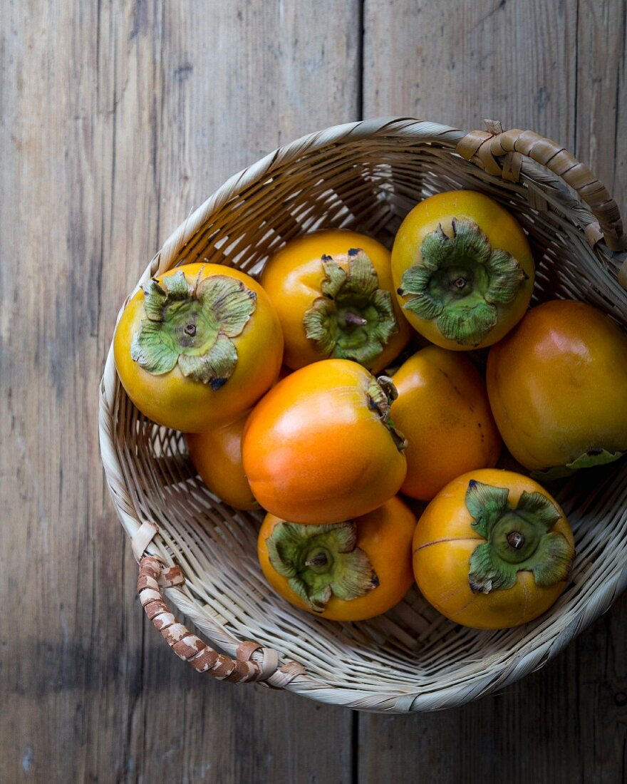 Fresh persimmons in a basket