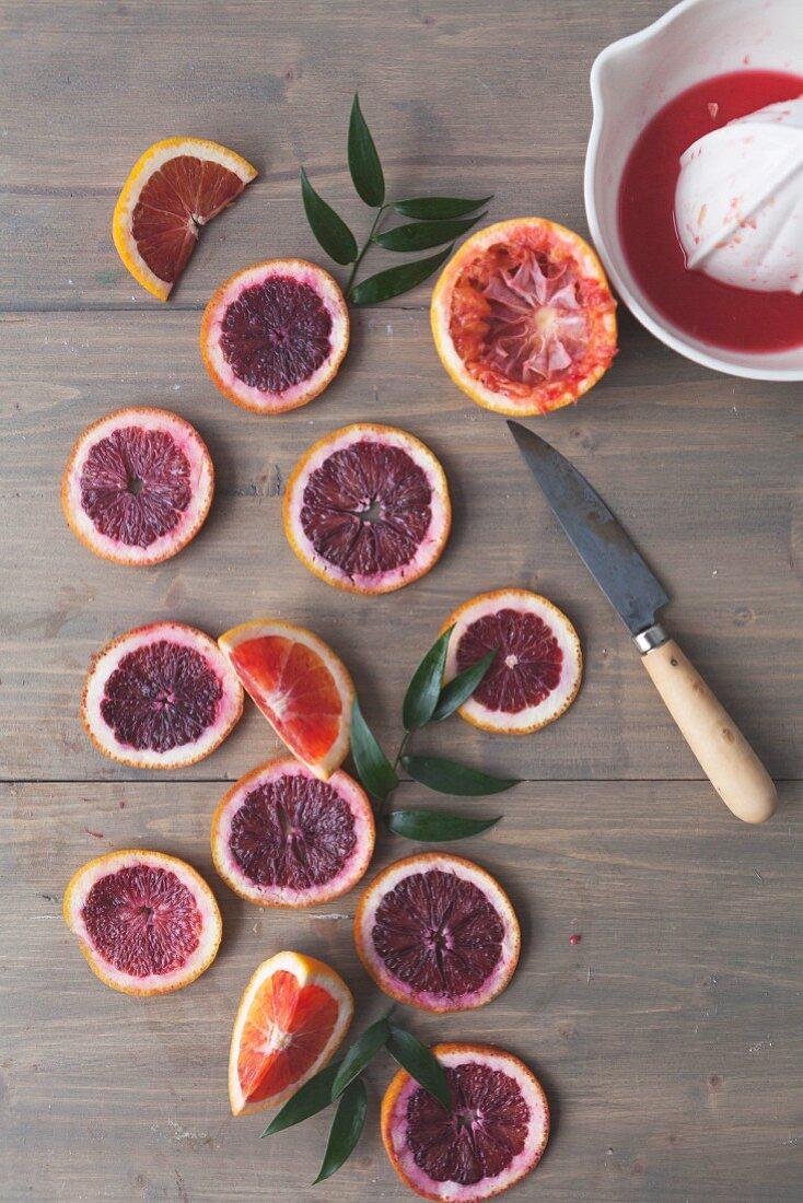 Blood orange slices with a citrus press