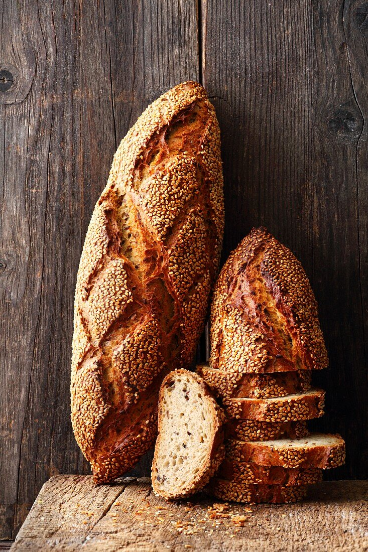 Crunchy loaves of bread topped with seeds