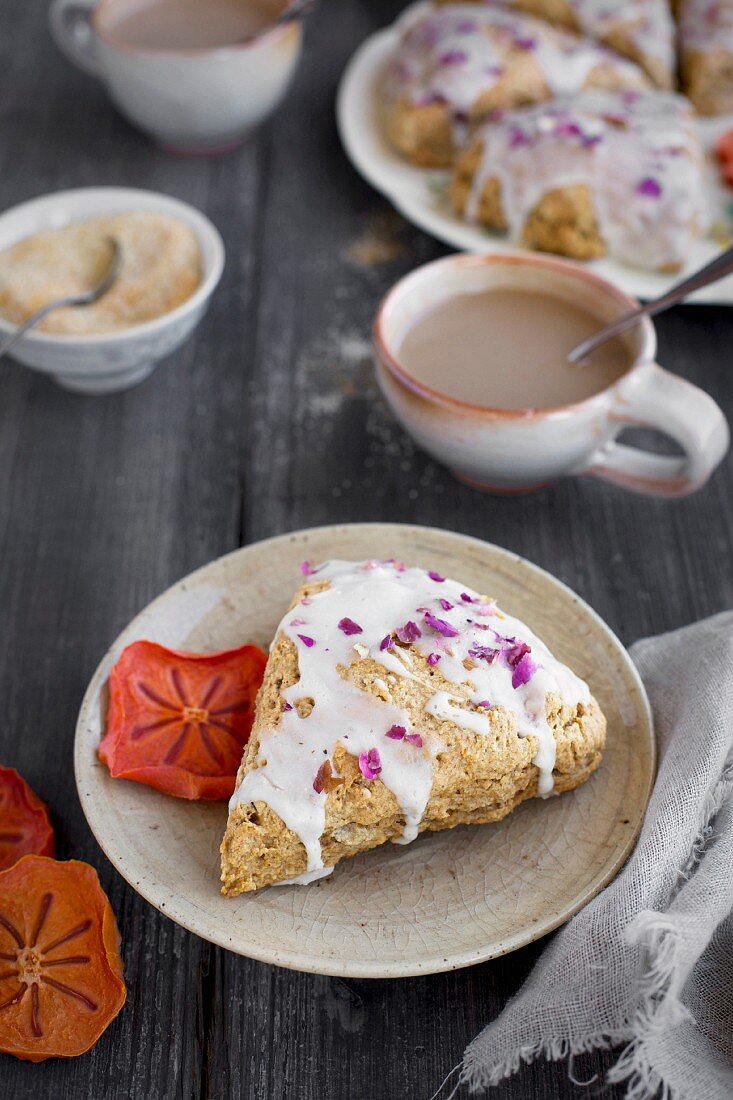 Persimmon Rose Scones served with espresso from front view on a rustic gray wood background