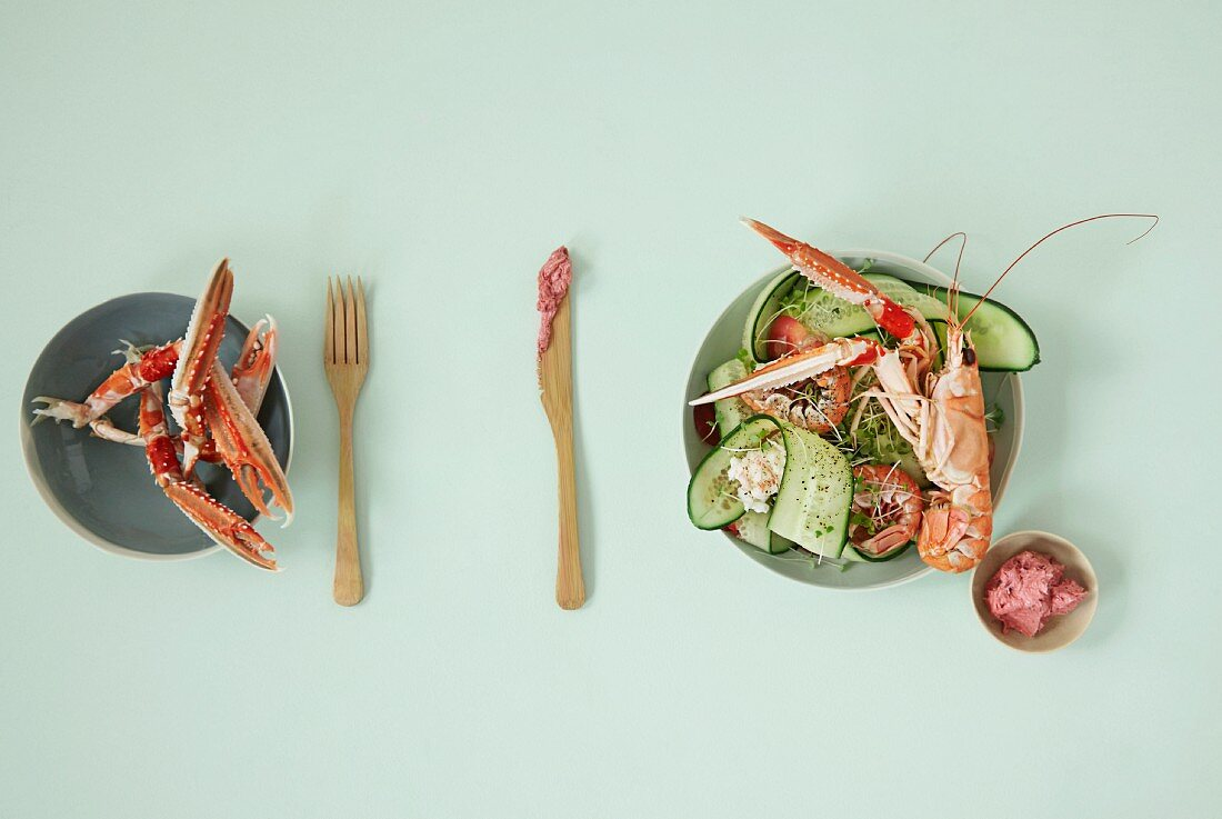 Cucumber and rhubarb salad with langoustines and beetroot butter