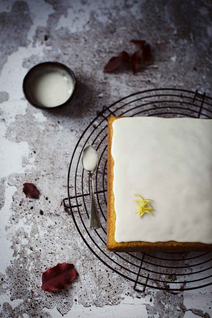 Soft and moist lemon pound cake with sour cream and lemon icing