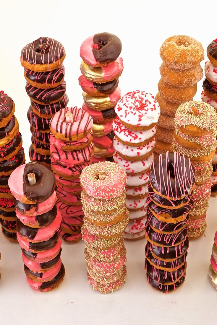 Different doughnut varieties stacked in towers