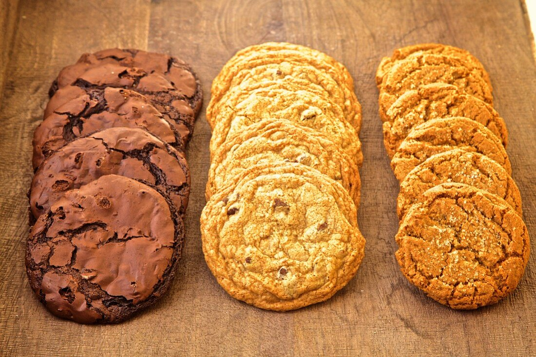 Chocolate, raisin bran, and oatmeal cookies on a white background