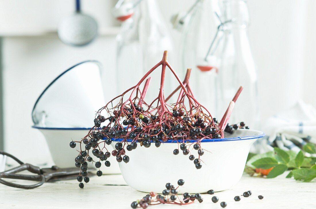 Ingredients and kitchen utensils for making homemade elderberry juice