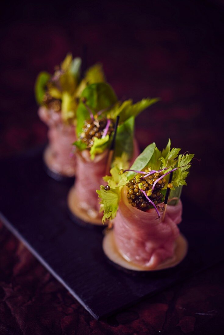 Veal carpaccio rolls filled with caviar