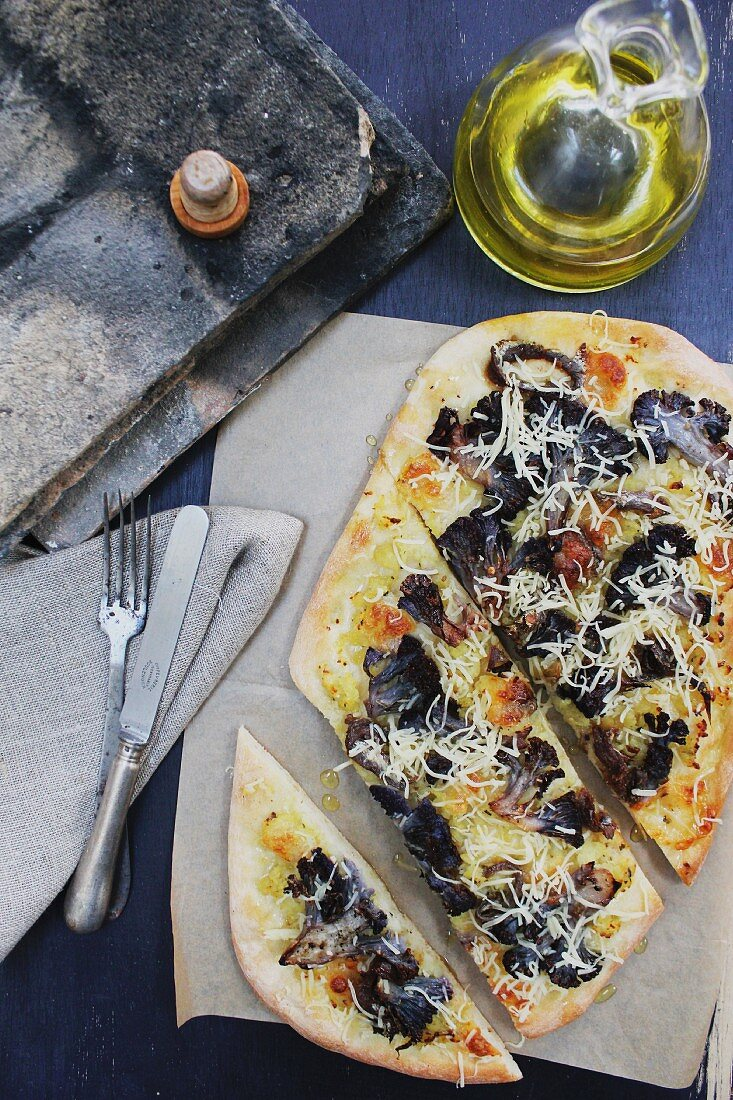 Pizza with black mushrooms and cheese