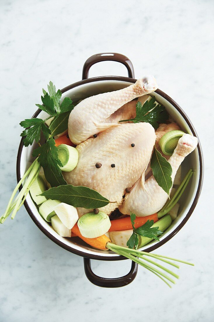 Ingredients for homemade chicken stock in a pan (seen from above)