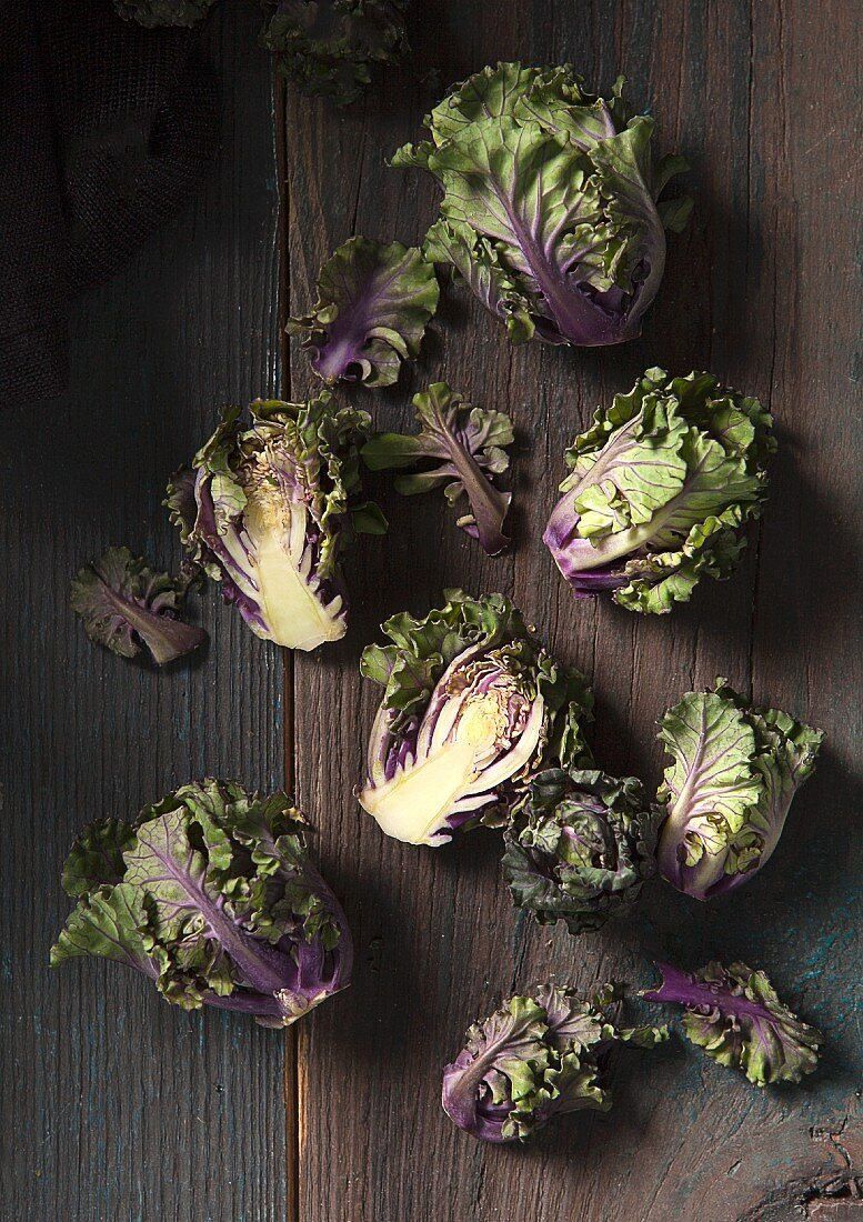 Kalette (or flower sprout) florets, a cross between brussels sprouts and kale, on a wooden background