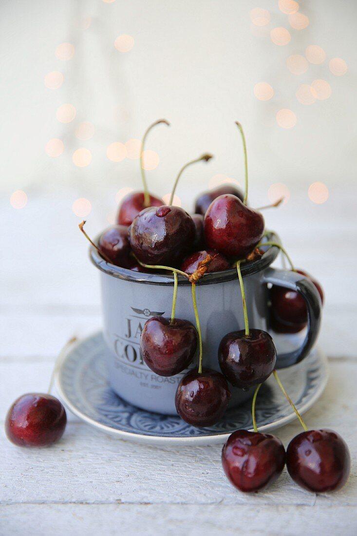 Cherries in an enamel mug