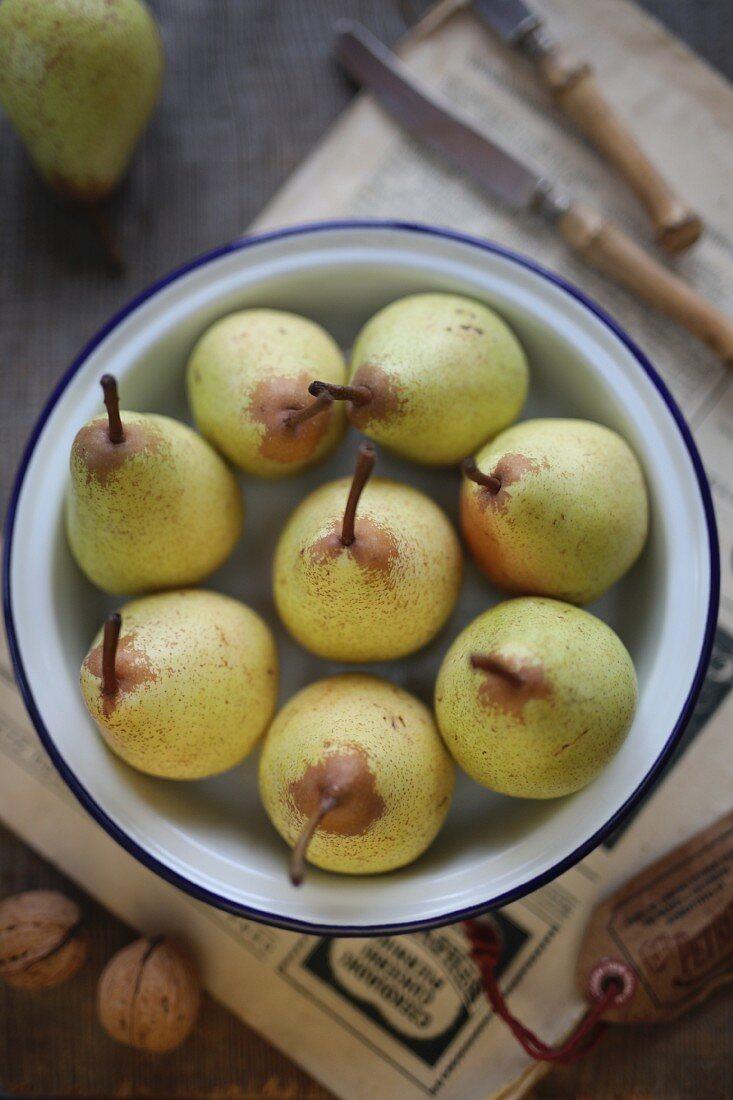 Pears in a metal bowl