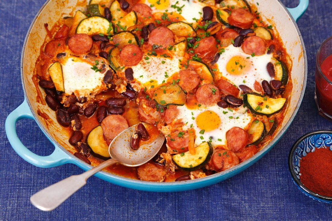 Sausage, kidney bean and courgette bake with eggs