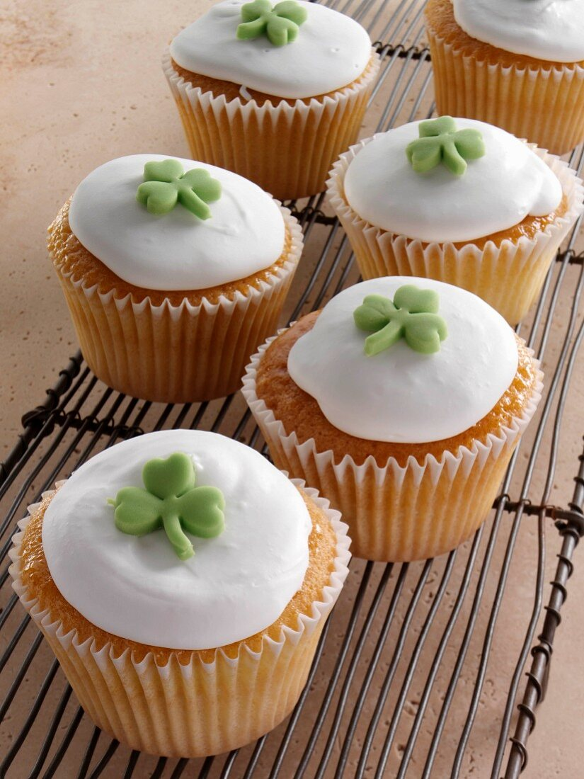 Cupcakes with a green shamrock on top of the white icing