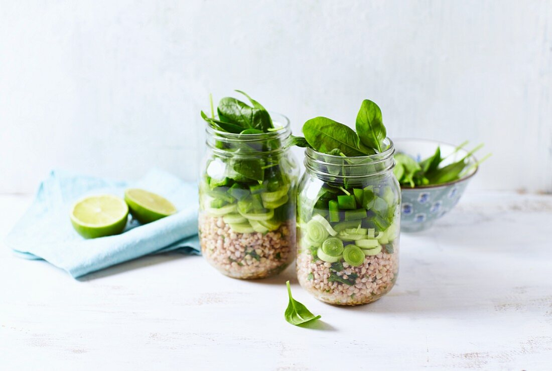 Layered buckwheat salad with leek, pepper and spinach in a jar