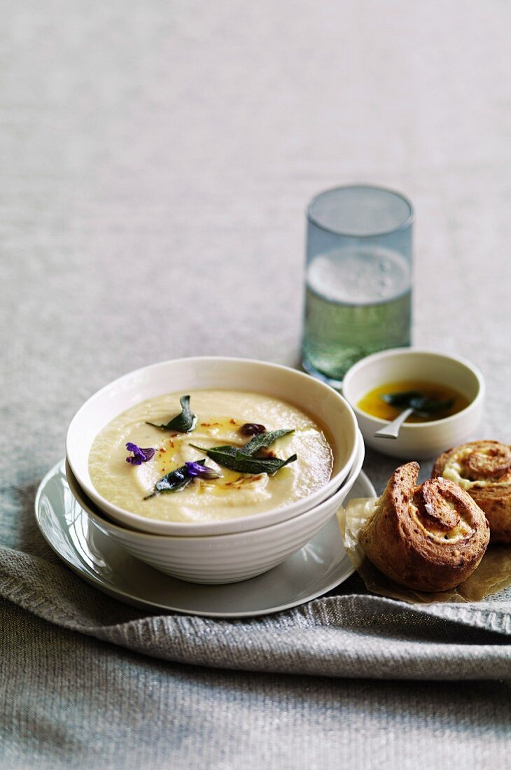 Roast garlic and parsnip soup with lemon and sage butter