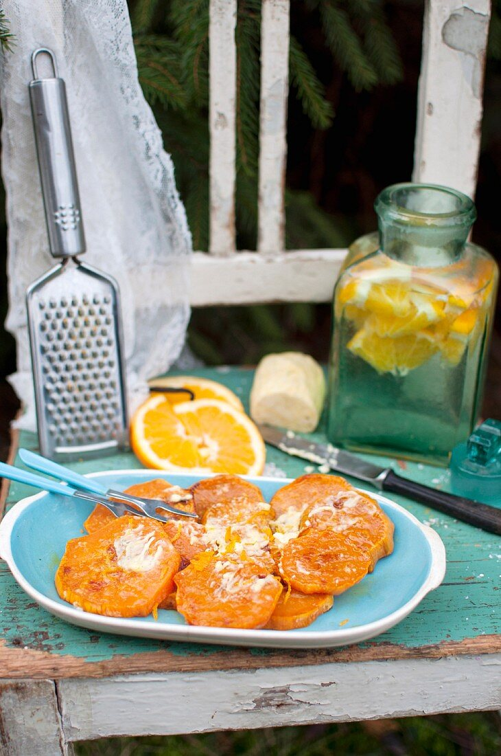 Slices of roasted sweet potato served with vanilla - orange butter
