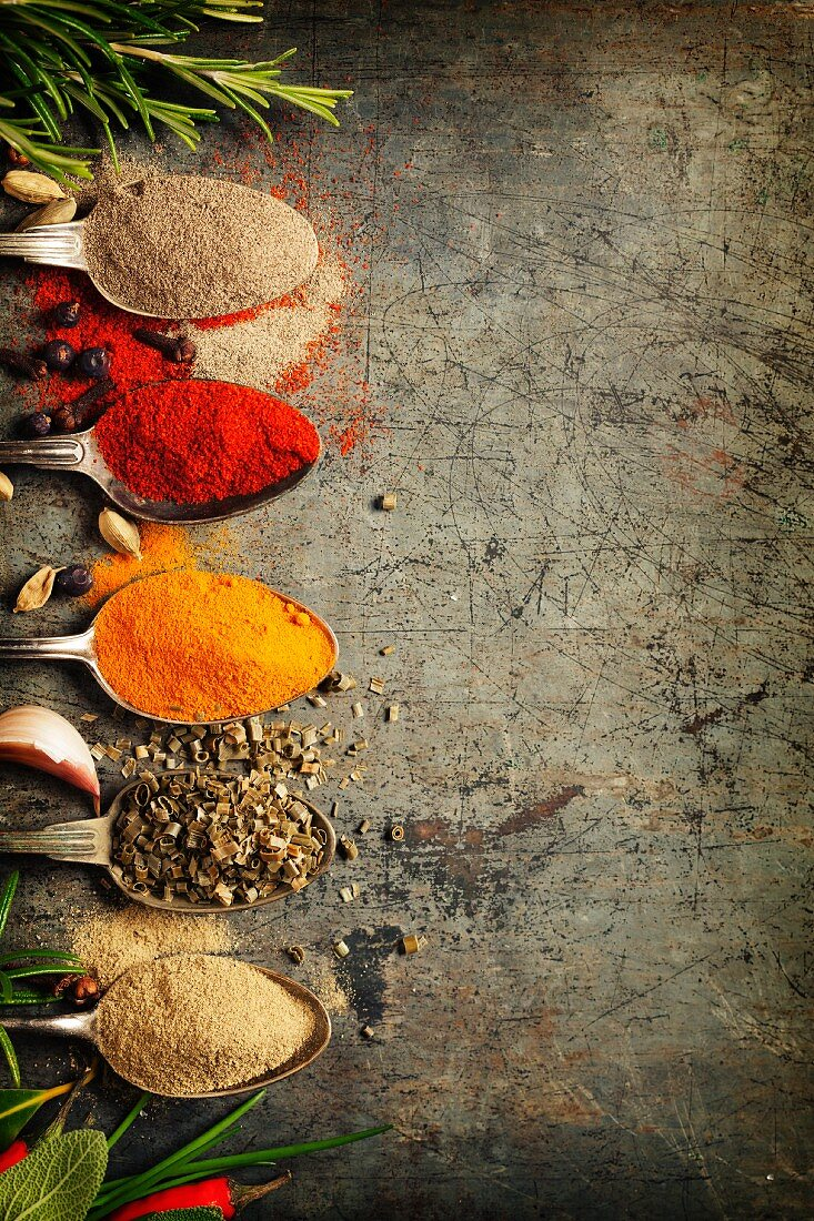 Herbs and spices selection on rustic background