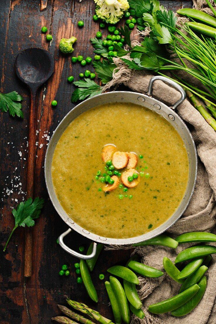 Vegetable cream soup on dark rustic background