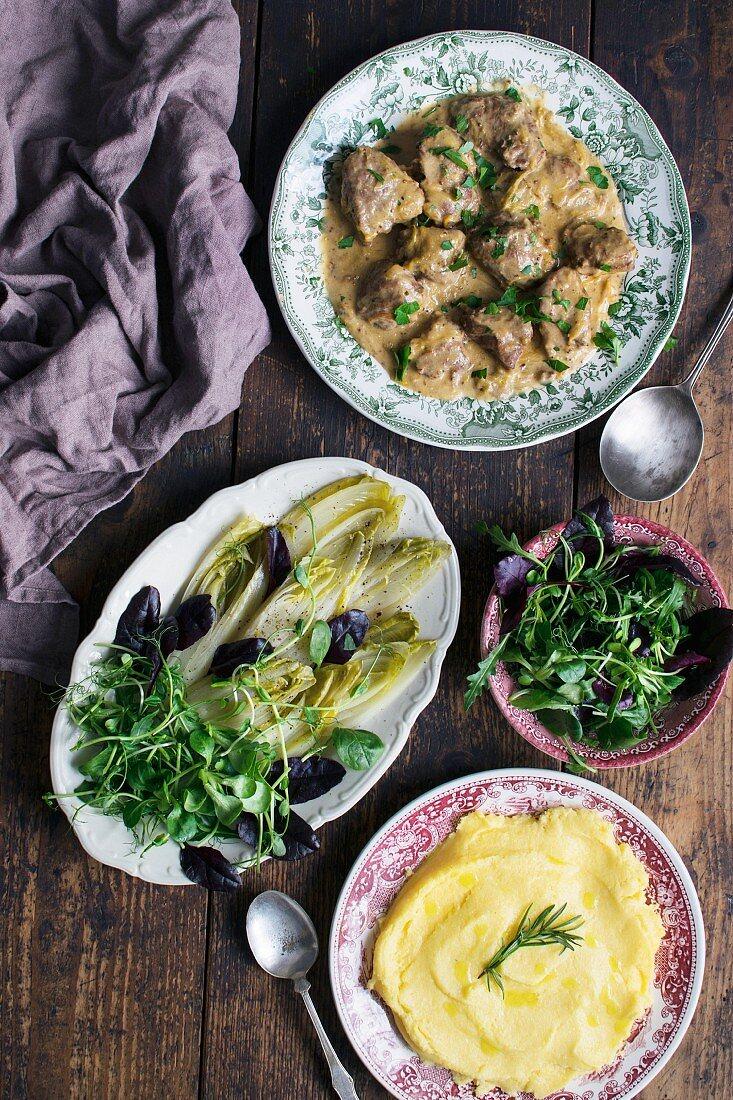 Braised Pig Cheeks, Braised Chokory, Fresh Salads Mix, Polenta