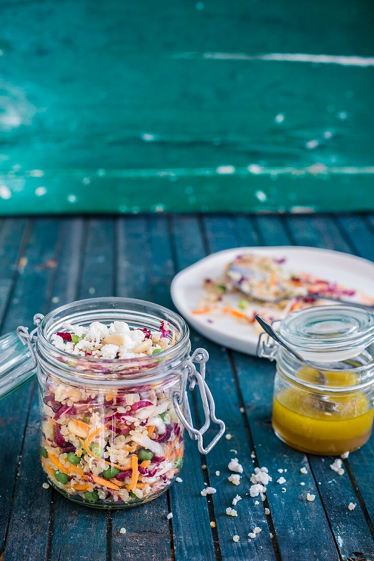 Quinoa and radish salad with mustard vinaigrette in a glass jar