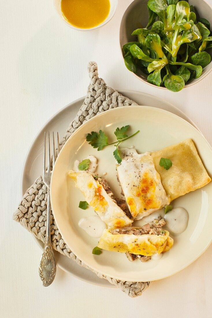 Mushroom-filled ravioli topped with melted parmesan, served with lamb's lettuce