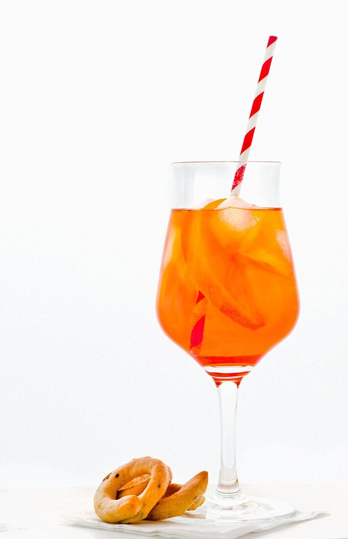 Aperol Spritz in a glass with straw