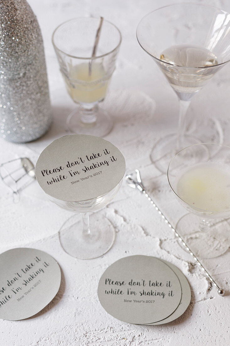 Pale cocktails with labelled cardboard lids