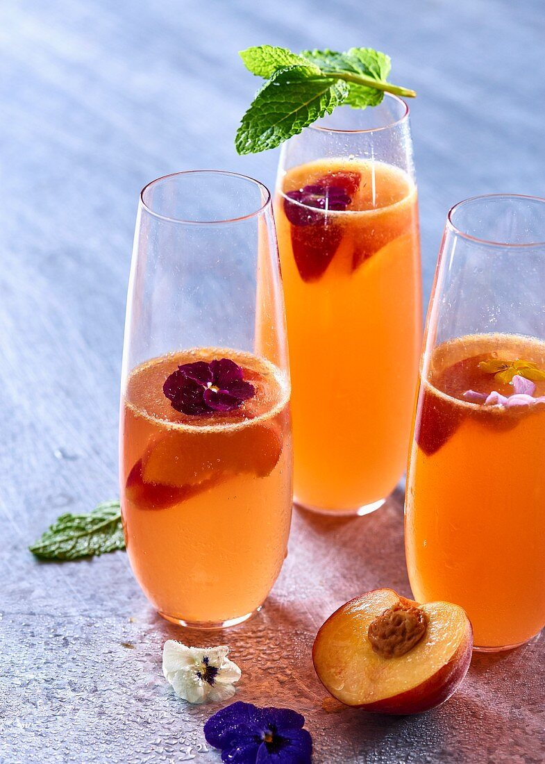 Nectarine sangria with flowers and mint