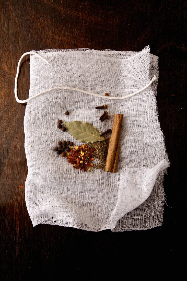 Bouquet garni being made with different spices