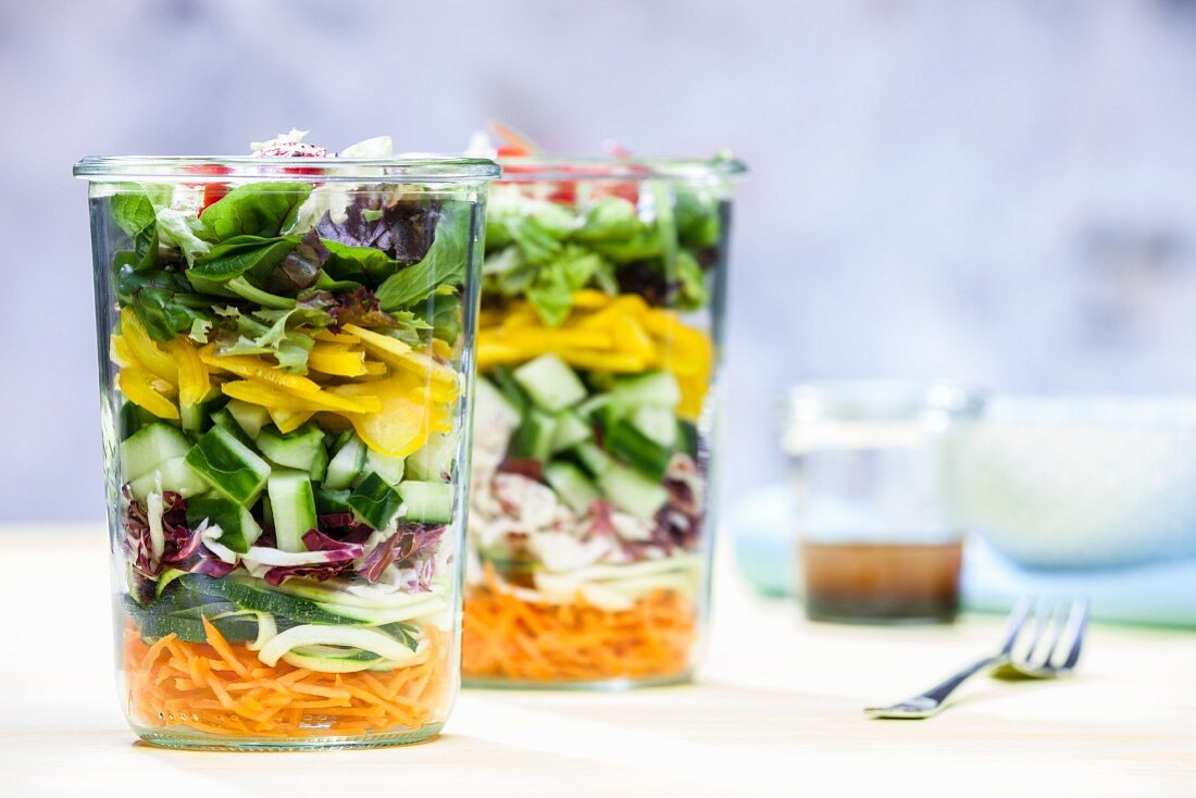 A layered vegetable salad in a glass