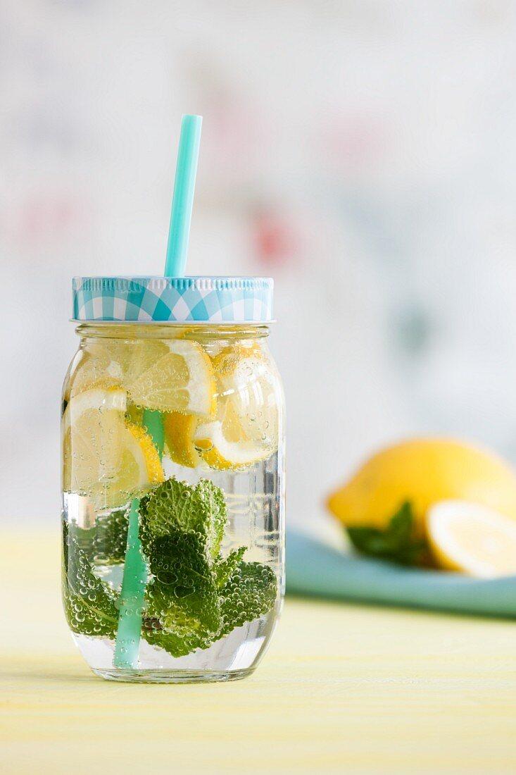 Lemonade with mint in a glass jar