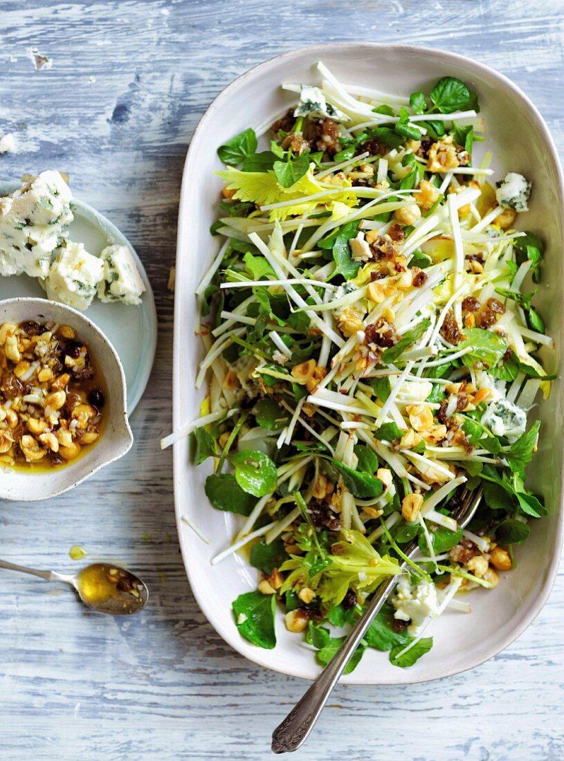 Apple, celery and Roquefort salad with roasted hazelnut-raisins