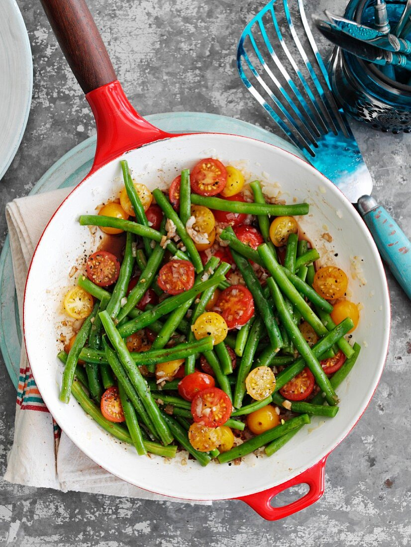 Green beans with red and yellow cherry tomatoes in a balsamic dressing