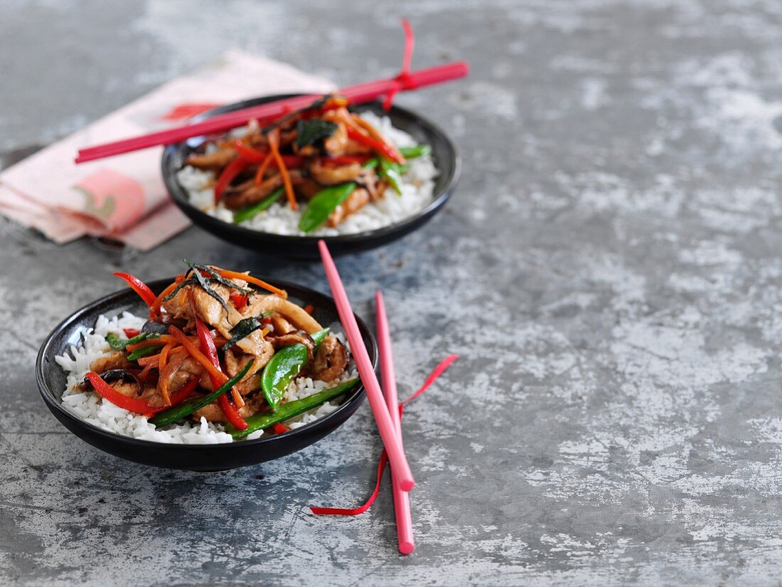 Yakitori Donburi (grilled chicken on rice, Japan) with vegetables and seaweed