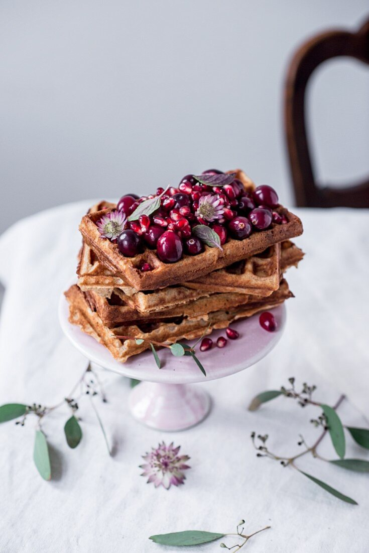 Belgian spelt waffles with warm cherries, cranberries, pomegranate seeds