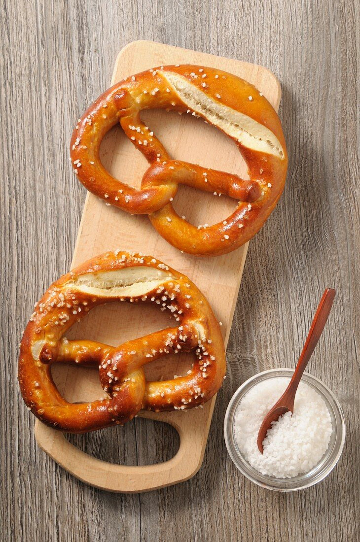 Two pretzels on a wooden board