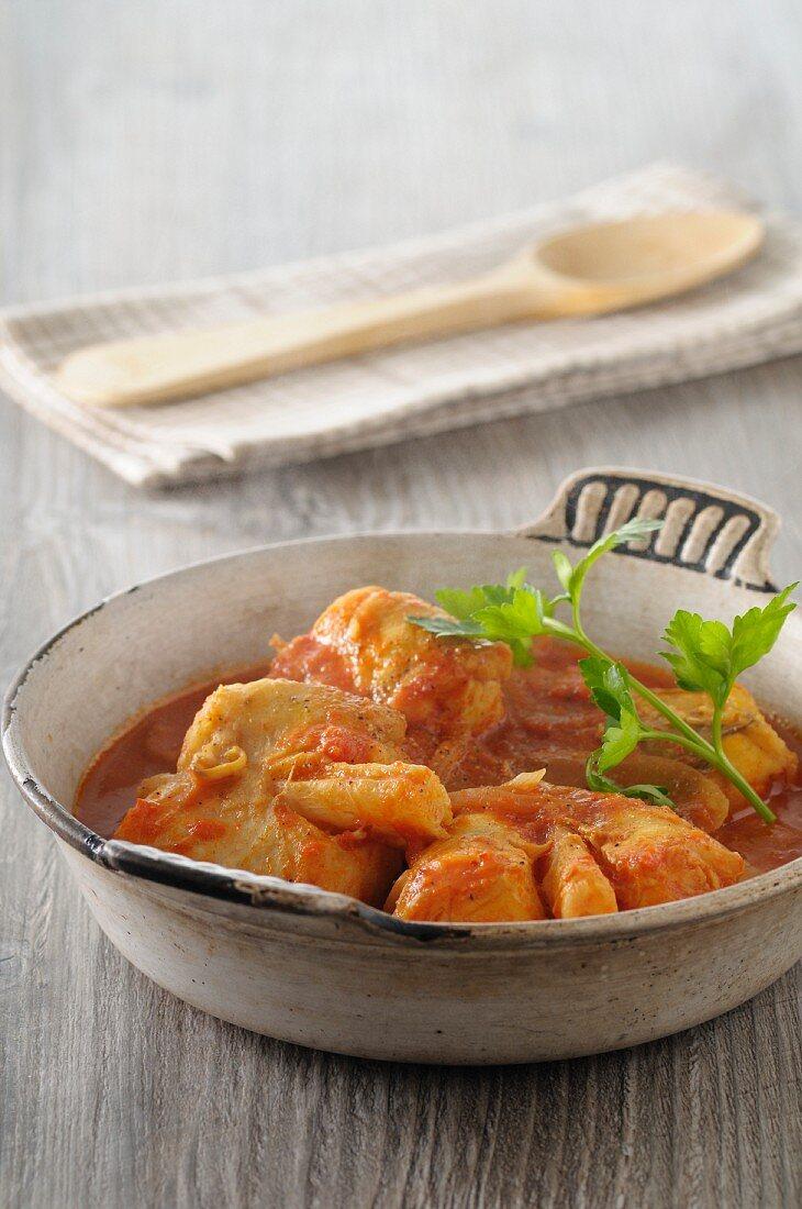 Monkfish in tomato sauce