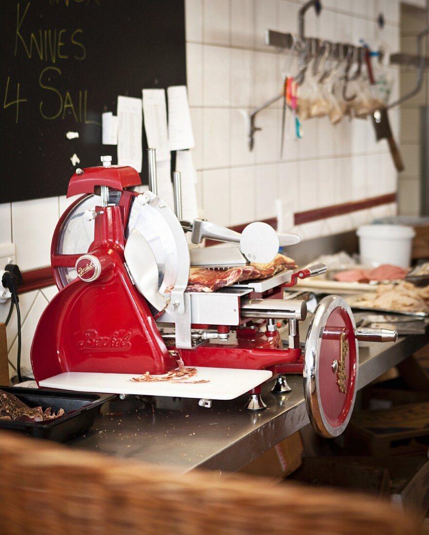 Parma ham being sliced in a machine