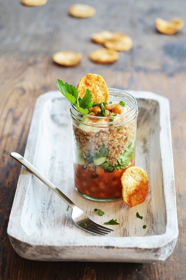 A bulgur wheat salad with chickpeas in a glass jar