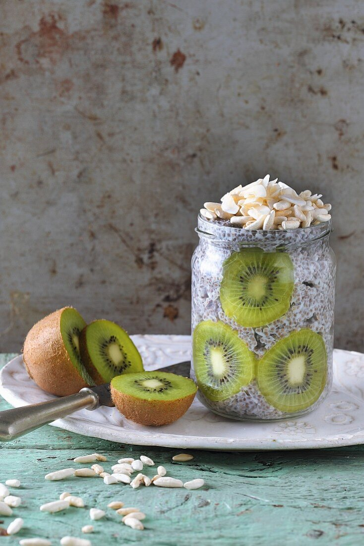 Chia pudding with kiwi and almonds in a glass jar