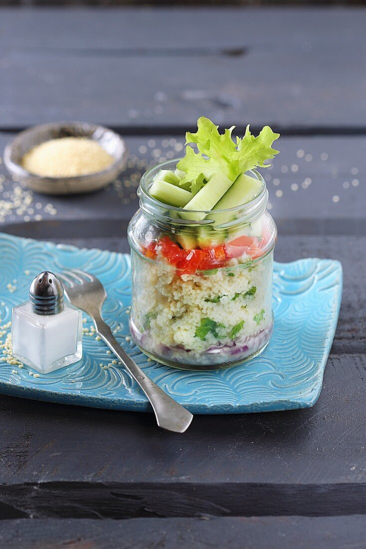 Couscous tabouleh in a glass jar
