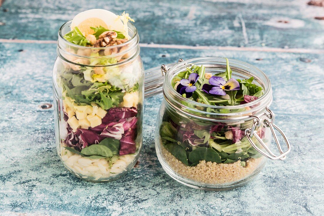 Orzo pasta salad and quinoa salad in glass jars