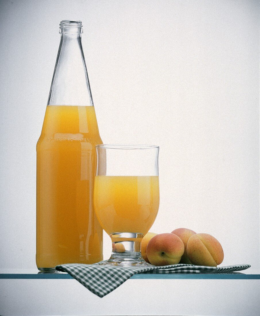 Peach Juice in a Bottle and in a Glass; Peaches